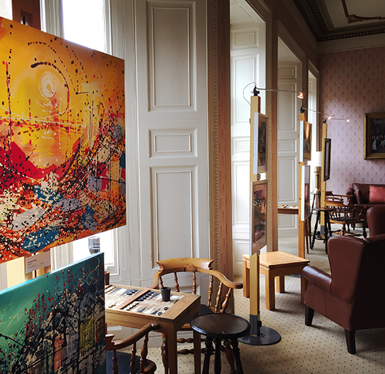 An artists group display their work in The Clifton Club in Clifton, Bristol with Art Posts